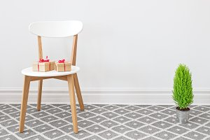 Presents on a chair and little tree