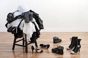 Heap of clothing on a black stool