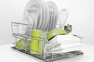 Bright dishes on metal dish rack