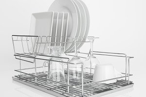 White dishes drying on dish rack