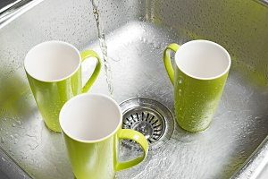 Green cups in the kitchen sink