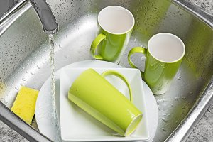 Washing green cups and plates
