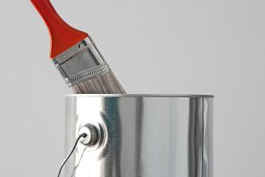 Paint bucket and red paintbrush