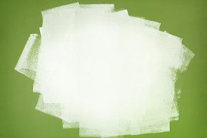 White paint on green wall