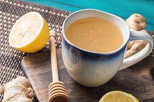Lemon ginger hot tea drink with