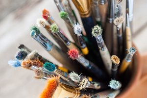 Painter paintbrushes in a jug
