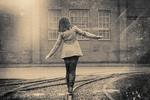 Girl walking on the railway