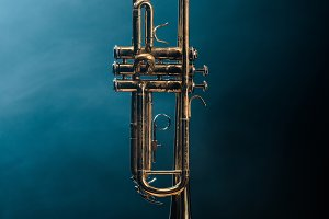 studio shot of trumpet on chair with