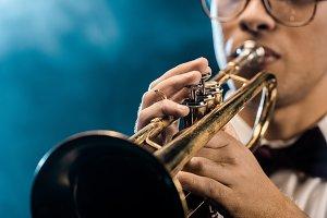 cropped shot of male musician playin