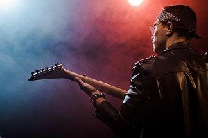 rear view of male musician in leathe