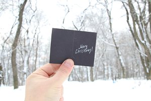hand holding a christmas card with