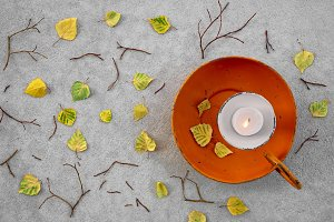 Autumn leaves and cozy candlelight
