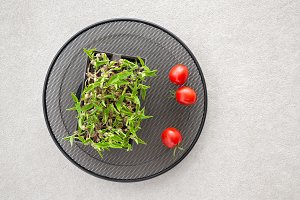 Green haricot sprouts and tomatoes