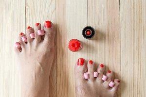 Woman painting toe nails