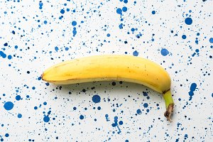 Banana on white and blue background