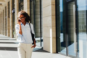 Woman walking at office building