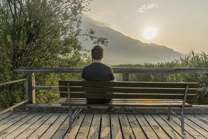 Man relaxing at sunrise