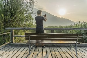 Man photographing the sunrise