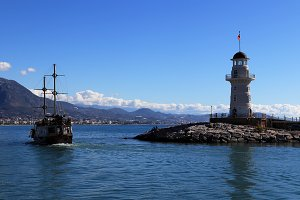 Sailing ship with lighthouse