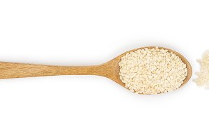 sesame seeds in a wooden spoon