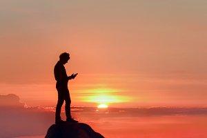 Successful businessman at sea sunset
