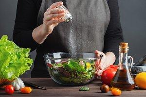 Woman chef in the kitchen preparing