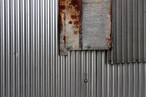Corrugated steel fence pieces wall