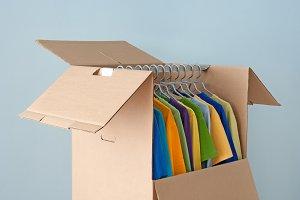 Bright clothes in a wardrobe box