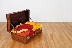Leather suitcase full of clothes
