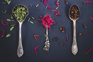 Silver spoons full of spices