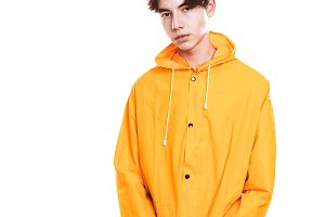 portrait of a teen guy in a yellow r