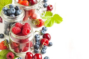 Summer berries in glass jar
