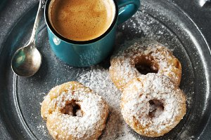 Donuts and cup of coffee.