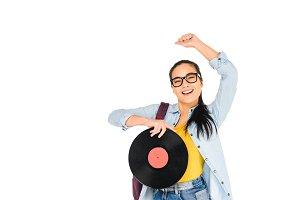 happy girl in glasses holding vinyl