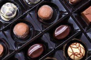 Chocolate candies in plastic case