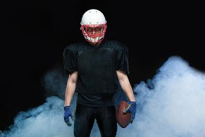 American football player in a black