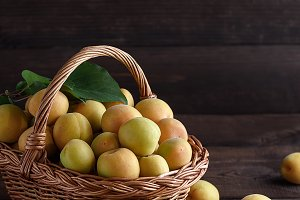 apricots in a brown wicker basket