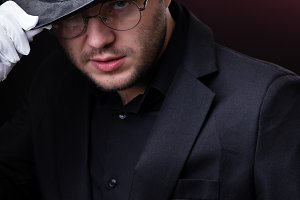 Photo of serious man in black hat in