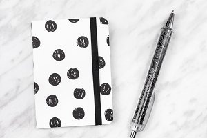 Black and white diary and pen