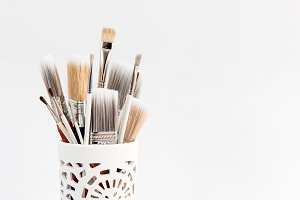Paintbrushes in a decorative vase
