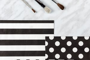 Paint brushes and decorative paper