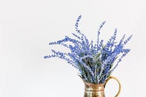 Blue lavender in antique metal jar