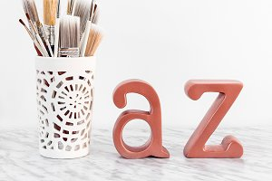 Paintbrushes with metal letters
