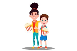 Boy And Girl With Popcorn In Hands
