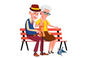 Elderly Couple Sitting On Bench In