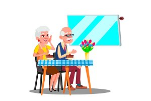 Happy Elderly Couple Sitting In Cafe