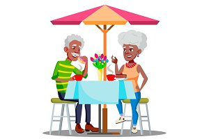 Happy Elderly Couple In Cafe At A