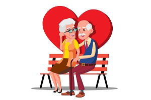 Elderly Couple Hugging On The Bench
