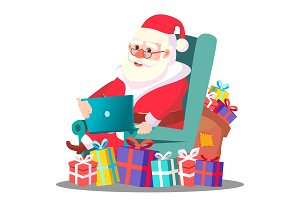 Santa Claus On The Chair With Laptop