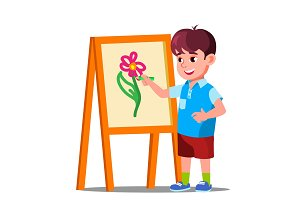 Little Boy Draws On Paper With